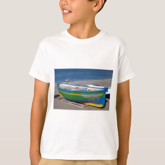 Old green fishing boat on beach. T-Shirt