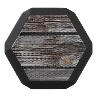 Old grey wooden boards black bluetooth speaker