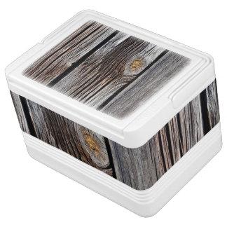 Old grey wooden boards igloo cool box