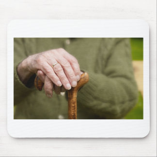 old hands OF A senior lean on walking stick Mouse Mat