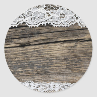 old lace on the wooden background round sticker