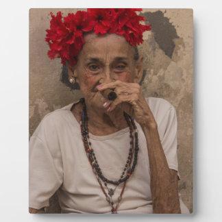 Old lady smoking cuban cigar in Havana Plaques