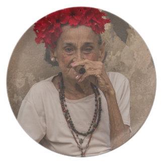 Old lady smoking cuban cigar in Havana Plate