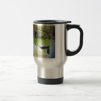 Old pier on a tranquil river mugs
