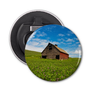 Old, red barn in field of chickpeas bottle opener