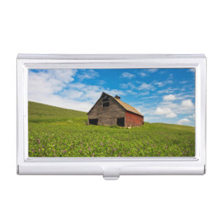 Old, red barn in field of chickpeas business card case