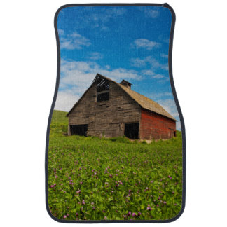 Old, red barn in field of chickpeas car mat