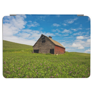 Old, red barn in field of chickpeas iPad air cover