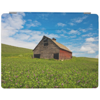 Old, red barn in field of chickpeas iPad cover