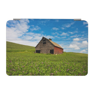 Old, red barn in field of chickpeas iPad mini cover