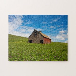 Old, red barn in field of chickpeas jigsaw puzzle