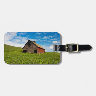 Old, red barn in field of chickpeas luggage tag