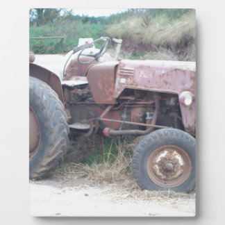 Old red tractor plaque