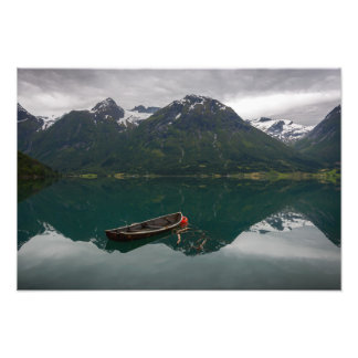 Old rowboat with mountain reflection photo print