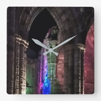 Old ruin. Illuminated Gothic arches square clock