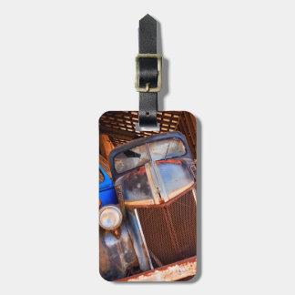 Old rusty truck on a farm bag tag