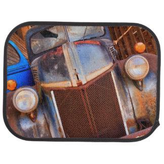 Old rusty truck on a farm floor mat