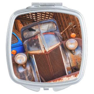 Old rusty truck on a farm vanity mirror