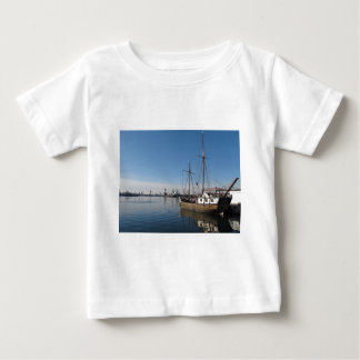 Old Ship in Calm Water Harbor Tshirts