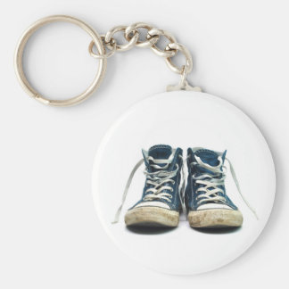 old sneakers dirty sport shoes white background keychain