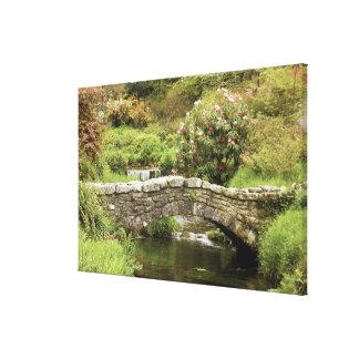 Old Stone Bridge Across A Stream In Dartmoor Park Canvas Print
