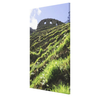 Old structure at top of steep hill canvas print