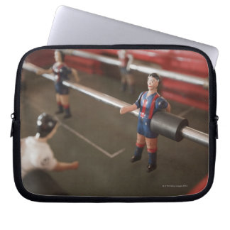 Old table football player laptop sleeve
