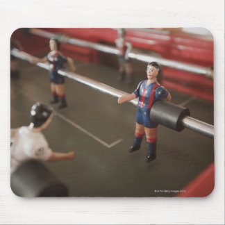 Old table football player mouse mat