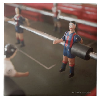 Old table football player tile