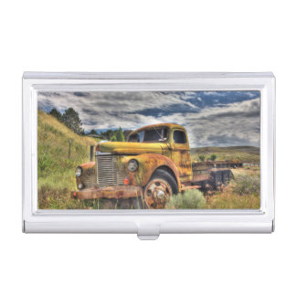 Old truck abandoned in field business card holder