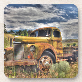 Old truck abandoned in field coaster