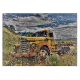 Old truck abandoned in field cutting board