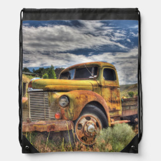 Old truck abandoned in field drawstring bag