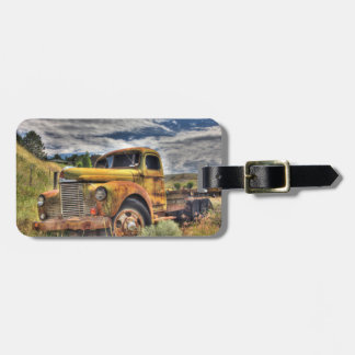 Old truck abandoned in field luggage tag