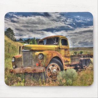 Old truck abandoned in field mouse pad