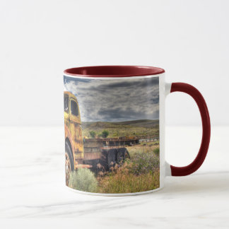 Old truck abandoned in field mug