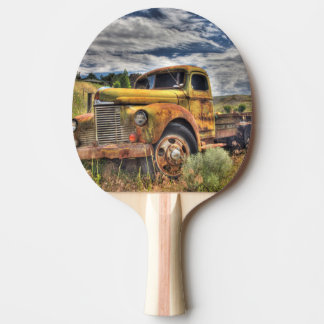 Old truck abandoned in field ping pong paddle