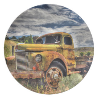 Old truck abandoned in field plate