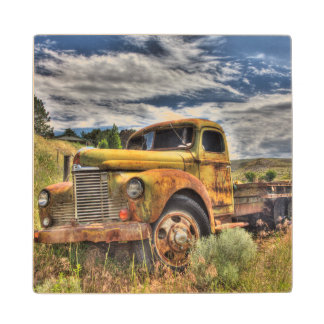 Old truck abandoned in field wood coaster