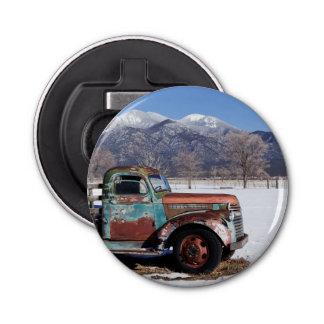 Old truck sitting in the field bottle opener