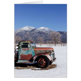 Old truck sitting in the field card