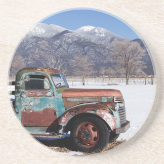 Old truck sitting in the field coaster