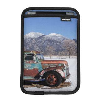 Old truck sitting in the field iPad mini sleeves