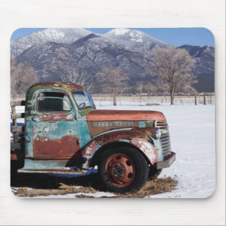 Old truck sitting in the field mouse mat