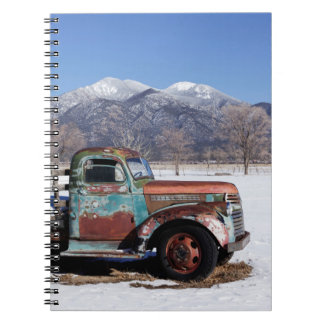 Old truck sitting in the field notebook