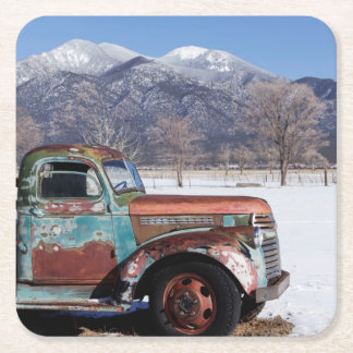 Old truck sitting in the field square paper coaster