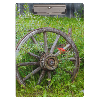 Old wagon wheel in historic old gold town 3 clipboard