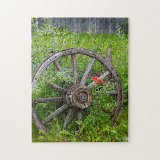 Old wagon wheel in historic old gold town 3 jigsaw puzzle