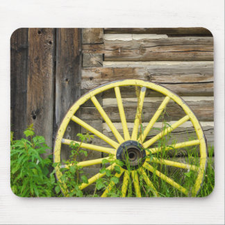 Old wagon wheel in historic old gold town mouse mat