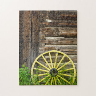 Old wagon wheel in historic old gold town puzzles
